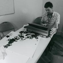 Joseph Bienvenu with Typewriter